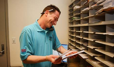 man checking mail in a mail room
