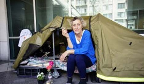 Woman in front of a tent