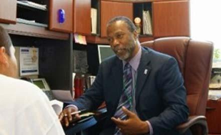 bearded man in a business suit talking